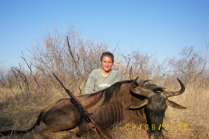 Sharon with Wildebees